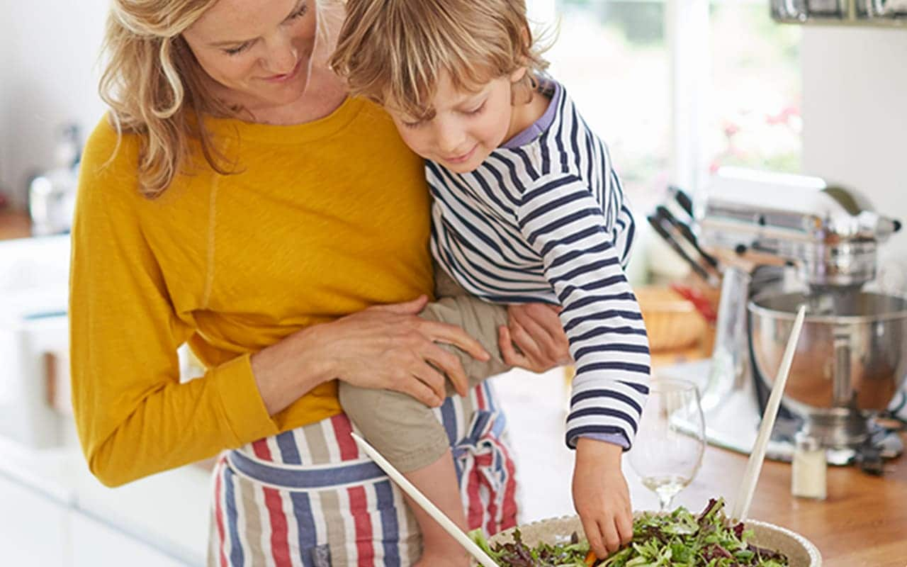 mother and son preparing plant-based meal