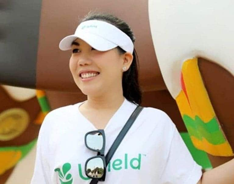 girl with Upfield's t-shirt and cap