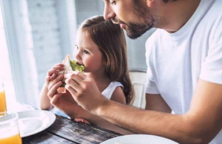 kid eating an avocado sandwich